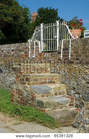 Steps In Brick Wall. Bosham. England