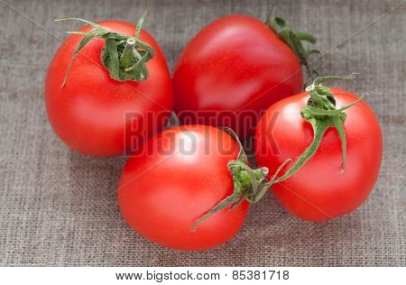 Several tomatoes on hessian linen fabric cloth texture