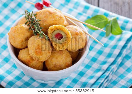 Appetizer Olives baked in cheddar dough