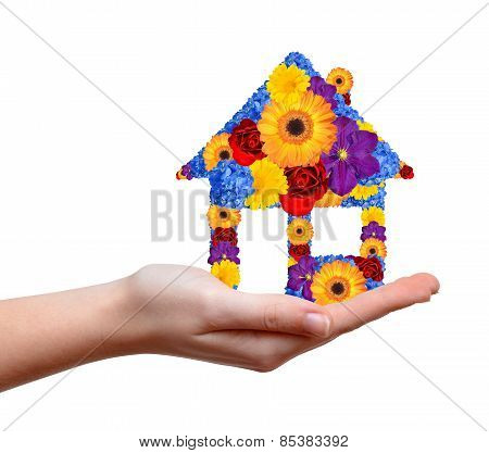 House symbol from flowers in hand