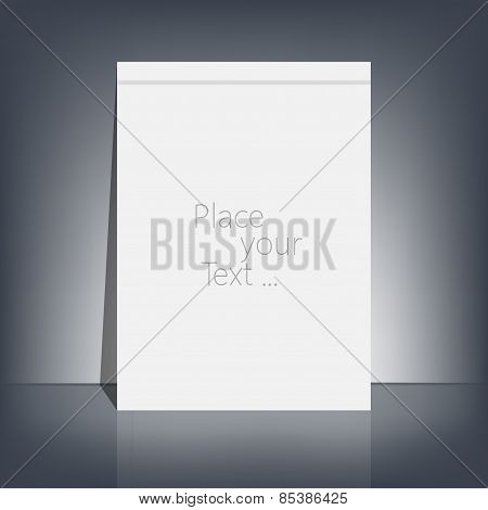 White blank stationary near the black wall with shadow. Magazine, book, flyer, booklet, cover or rep