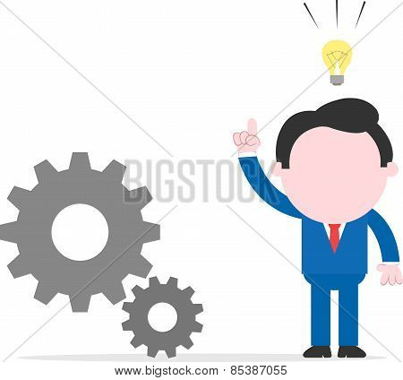 Businessman With An Idea Beside Gears