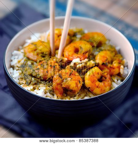 Curry prawns shrimp and rice in a bowl Caribbean food