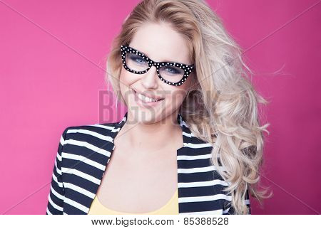 Successful young attractive blonde woman wearing glasses