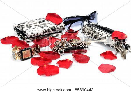 A Red rose petals, women's accessory Handbag for keys, wallet, watch. in still life