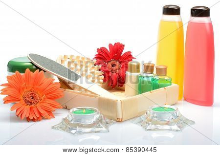 Still life with objects for Spa, body care-towels, candles, massager and flowers gerbera