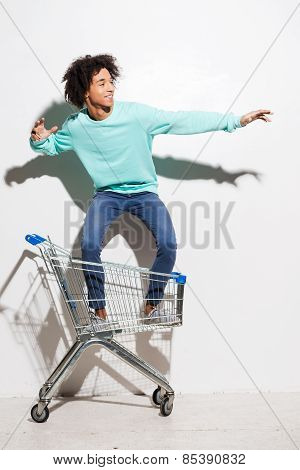 Riding A Shopping Cart.