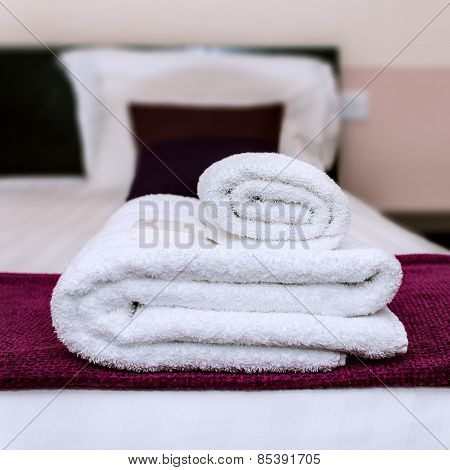 Closeup clean towels and soap in hotel room