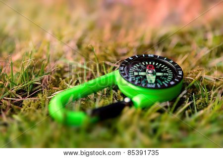 Compass on the grass close up outdoors concept