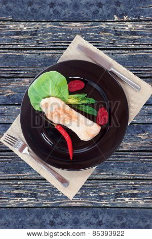 fresh roast turkey meat fillet steak served with vegetables on plate over blue wooden table