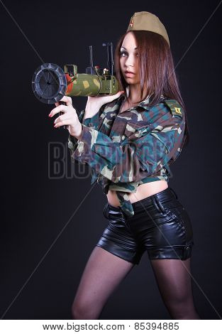 Woman In The Military Uniform With A Grenade Launcher