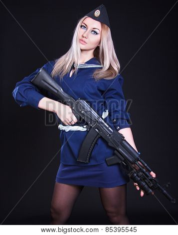 Woman In The Marine Uniform With An Assault Rifle
