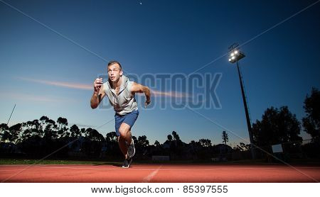 Male fitness model training for sprinting on an athletic track