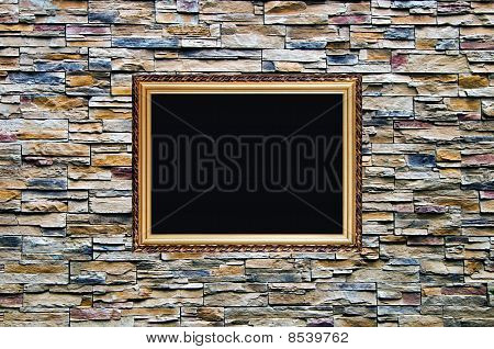 The Bright Ornamental Stone Wall With Old Style Wodden Frame With Stucco Moulding