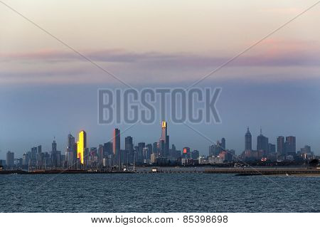 Melbourne Australia Cityscape. View Over Water At Sunset