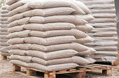 pic of pallet  - Pile of sacks of pellets which are stacked on pallets - JPG