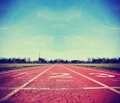 stock photo of toned  -  Athlete Track or Running Track with three numbers  - JPG