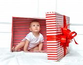 picture of christmas baby  - Infant child baby toddler kid sitting in presents gift for celebration for birthday - JPG