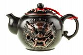 foto of teapot  - a decorated dark japanese teapot isolated over a white background - JPG