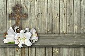 image of easter lily  - christian cross and three white lily on wood grey background - JPG