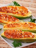 stock photo of zucchini  - Stuffed zucchini with cheese baked with mozzarella - JPG