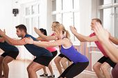 stock photo of bottom  - Group of people strengthening bottom muscles during fitness classes - JPG