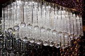 picture of chandelier  - Contemporary glass chandelier isolated over black background - JPG