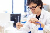 stock photo of scientific research  - Male researcher carrying out scientific research in a lab  - JPG