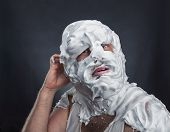 pic of crazy face  - Crazy man with face completely in shaving foam - JPG