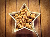 pic of roughage  - A bowl of healthy granola on a wooden surface - JPG