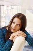 picture of daydreaming  - Young casual caucasian woman daydreaming at bright home - JPG