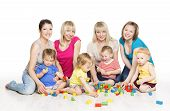 stock photo of child development  - Children Group with Mothers Playing Toy Blocks - JPG