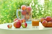 picture of apricot  - Juice of apricot and apricots on the table - JPG