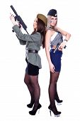 picture of cap gun  - Two women in the military uniform with a guns isolated over white background