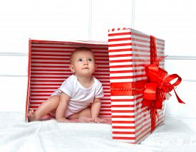 picture of new years baby  - Infant child baby toddler kid sitting in presents gift for celebration for birthday - JPG
