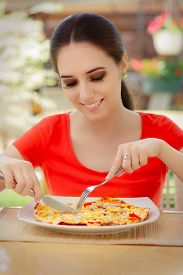 pic of table manners  - Beautiful girl eating pizza in a restaurant