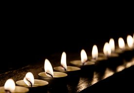 picture of tribute  - Lit candles in a row at night - JPG