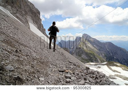 Hiker In High Mountains