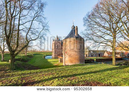Historic Dutch Castle In Low Sunlight