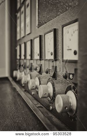 Instrument Panel With Circuit Breakers And Switches. Sepia