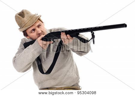 Hunter Takes Aim From A Gun On The White Background