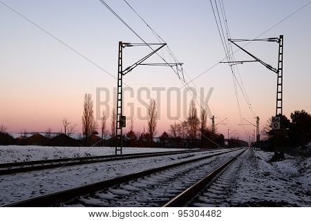 Railroad platform over sunset