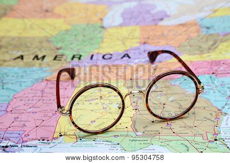 Glasses on a map of USA - Alabama