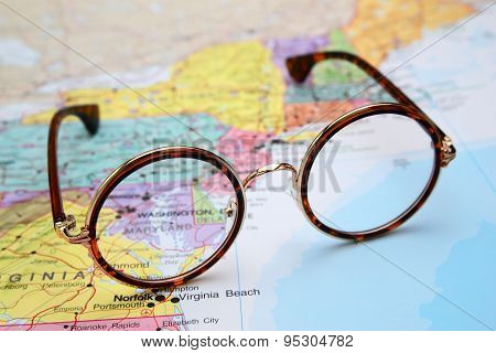 Glasses on a map of USA - Maryland