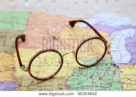 Glasses on a map of USA - Iowa