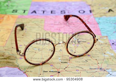 Glasses on a map of USA - Texas