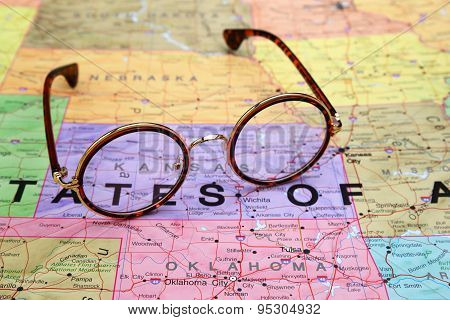 Glasses on a map of USA - Kansas