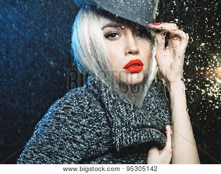 Woman Looking Through The Wet Window