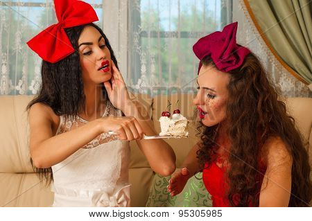 two beautiful woman dolls for a tea party