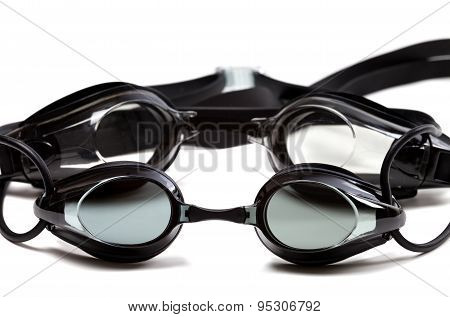 Two Black Goggles For Swimming On White Background